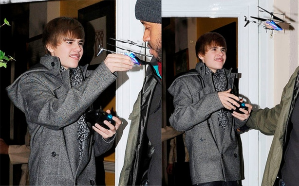 Pansy Justin Bieber playing with wimpy  RC helicopter knock-off from China.